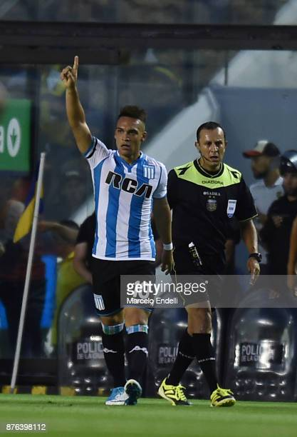 Lautaro Martinez of Racing Club celebrates with teammates after scoring the first goal of his team during a match between Boca Juniors and Racing...