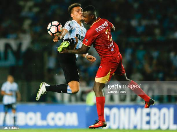 Lautaro Martinez of Racing Club fights for the ball with Hanyer Mosquera of Rionegro Aguilas during a first leg match between Racing and Rionegro...
