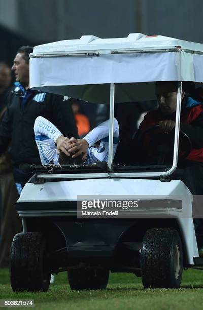 Lautaro Martinez of Racing Club leaves the field injured during the first leg match between Racing Club and Independiente Medellin as part of second...