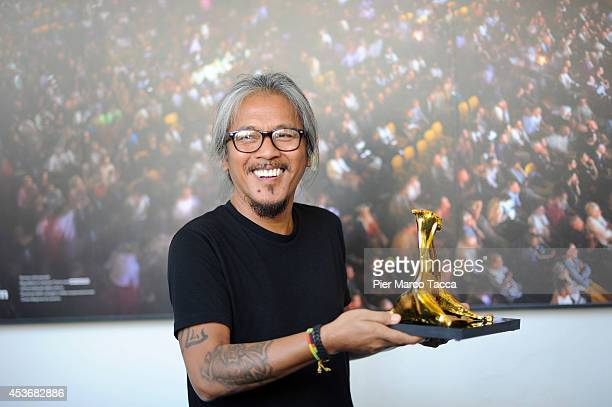 Lav Diaz Pardo d'Oro International Competition winner attends Palmares Photocall during the 67th Locarno Film Festival on August 16 2014 in Locarno...