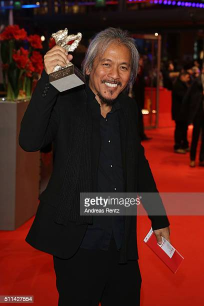 Lav Diaz poses with the award of the Silver Bear Alfred Bauer Prize for his movie 'A Lullaby to the Sorrowful Mystery' after the closing ceremony of...