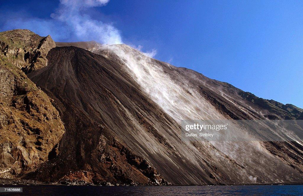 Lava covered Sciarra del Fuoco steams with fresh lava flow, Italy