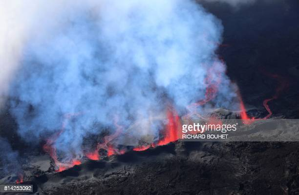 Lava errupts and flows from the Piton de la Fournaise the volcano of the French Indian Ocean island of Reunion which erupted early on July 14 2017...