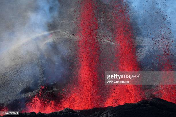 Lava errupts from the Piton de la Fournaise the volcano of the French Indian Ocean island of Reunion which erupted early on July 14 2017 according to...