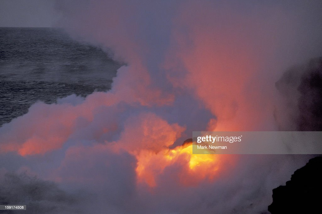 Lava Flowing into the ocean : Stock Photo