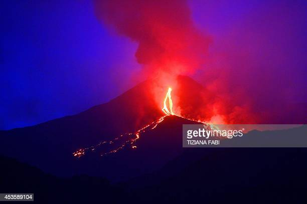 Lava flows from the Mount Etna volcano on the southern Italian island of Sicily near Catania on August 13 2014 Mount Etna is one of the most active...
