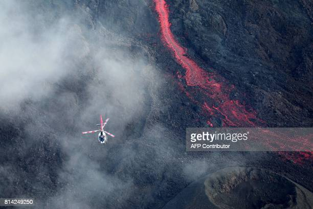 Lava flows from the Piton de la Fournaise the volcano of the French Indian Ocean island of Reunion which erupted early on July 14 2017 according to...