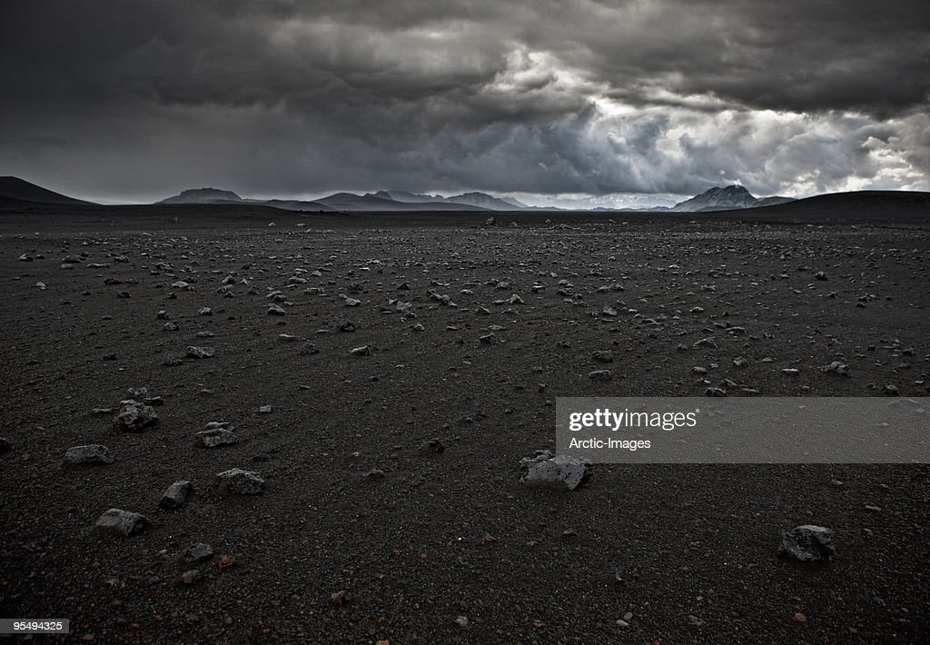 Lava rocks and black sands, storm approaching : Stock Photo