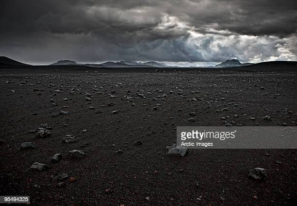 Lava rocks and black sands, storm approaching