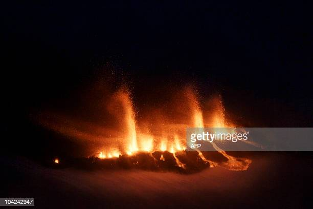 Lava spews out of a mountain on March 21 2010 in the region of the Eyjafjallajoekull glacier in Iceland A volcano in the area of the Eyjafallajoekull...