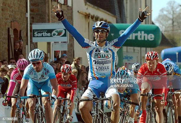 Italian rider Alberto Loddo of the Selle Italia team raises his arms in victory as he crosses the finish line of the third stage of the Circuit de la...