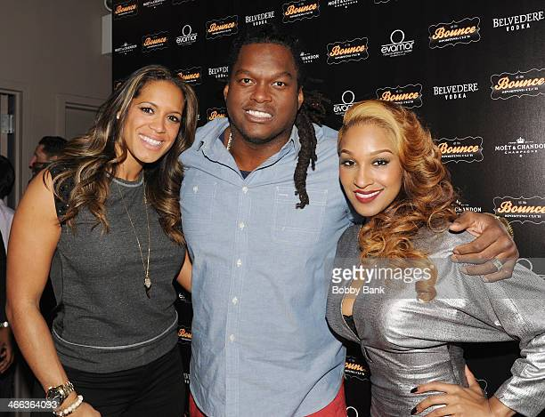 Lavar Arrington and Olivia Longott attends Bounce Sporting Club Big Ticket Weekend Day 1 at Bounce Sporting Club on January 31 2014 in New York City