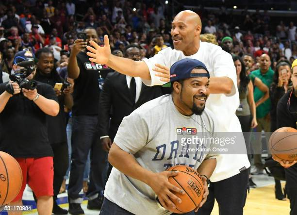 LaVar Ball and Ice Cube compete in a four point shooting challenge during the BIG3 game event at Staples Center on August 13 2017 in Los Angeles...
