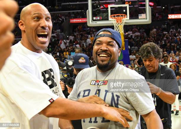 LaVar Ball and ice Cube compete in a four point shooting contest during the BIG3 game event at Staples Center on August 13 2017 in Los Angeles...