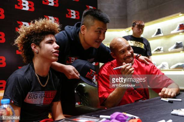 LaVar Ball father of LiAngelo Ball and the owner of the Big Baller brand and his youngest son LaMelo Ball pose for a photo with a fan during a...