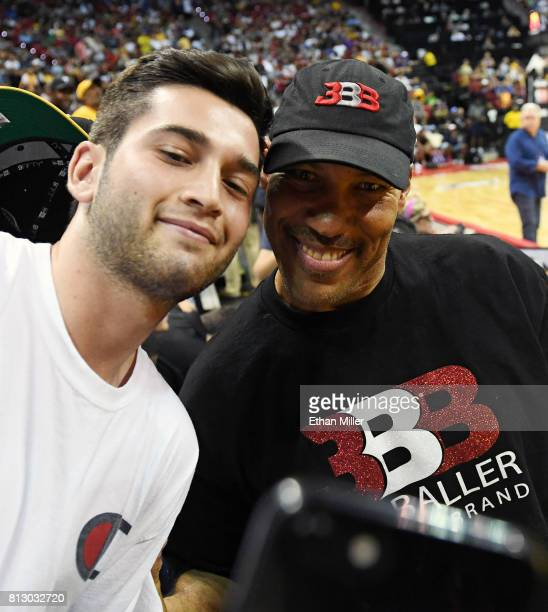 LaVar Ball father of Lonzo Ball of the Los Angeles Lakers poses for a selfie with a fan at halftime of a 2017 Summer League game between the Lakers...