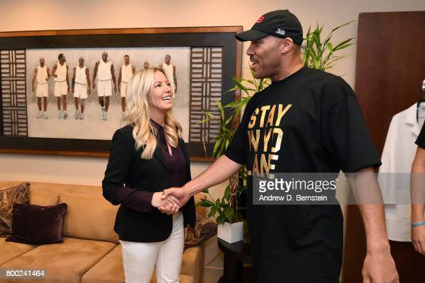 LaVar Ball shakes hands with Los Angeles Lakers President Jeanie Buss in the locker room following a press conference to introduce Los Angeles Lakers...