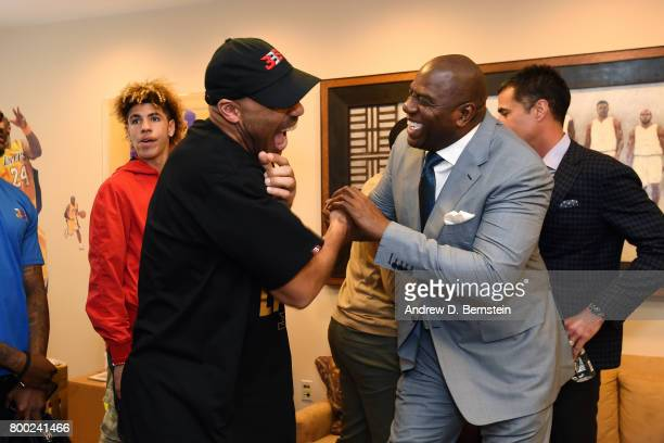 LaVar Ball shakes hands with President of Basketball Operation of the Los Angeles Lakers Magic Johnson following a press conference to introduce Los...