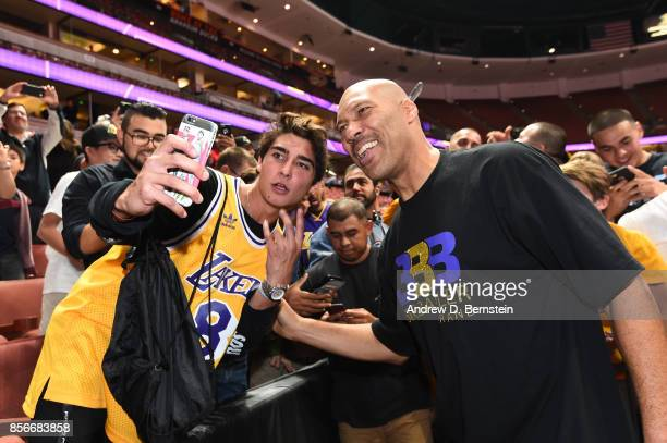 LaVar Ball takes a picture with a fan after the game between the Los Angeles Lakers and the Minnesota Timberwolves during the preseason game on...