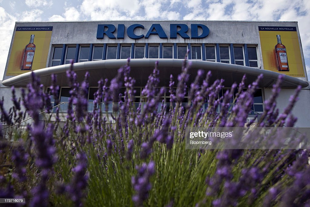 Lavender blooms in front of the bottling plant of wine and spirits producer Pernod Ricard SA in Bordeaux, France, on Tuesday, July 16, 2013. Distillers such as Diageo and Pernod Ricard SA are seeking to expand in emerging markets where booming economic growth is creating a burgeoning middle class with more disposable income. Photographer: Balint Porneczi/Bloomberg via Getty Images