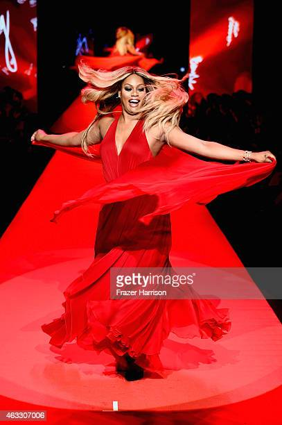 Laverne Cox walks the runway at the Go Red For Women Red Dress Collection 2015 presented by Macy's fashion show during MercedesBenz Fashion Week Fall...