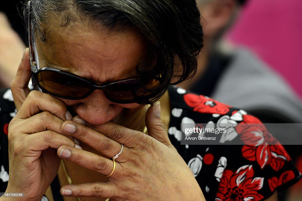 Lavette Michelle Noel cries as she tells her boss that she is not coming into work today after she married Delani Eugene Simmons during a Valentine's Day marriage celebration at the Denver Clerk and Recorder's office. Couples applying for marriage licenses received gift bags containing gift certificates to local restaurants among other treats to celebrate their union.