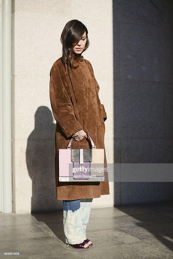 Lavinia Biancalani poses wearing a vintage coat and Giancarlo Petriglia bag on February 26 2015 in Milan Italy