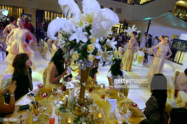 A lavish party and fashion show is hosted by an Indonesian high society magazine at an upscale mall in the capital city of Jakarta on March 20 2013...
