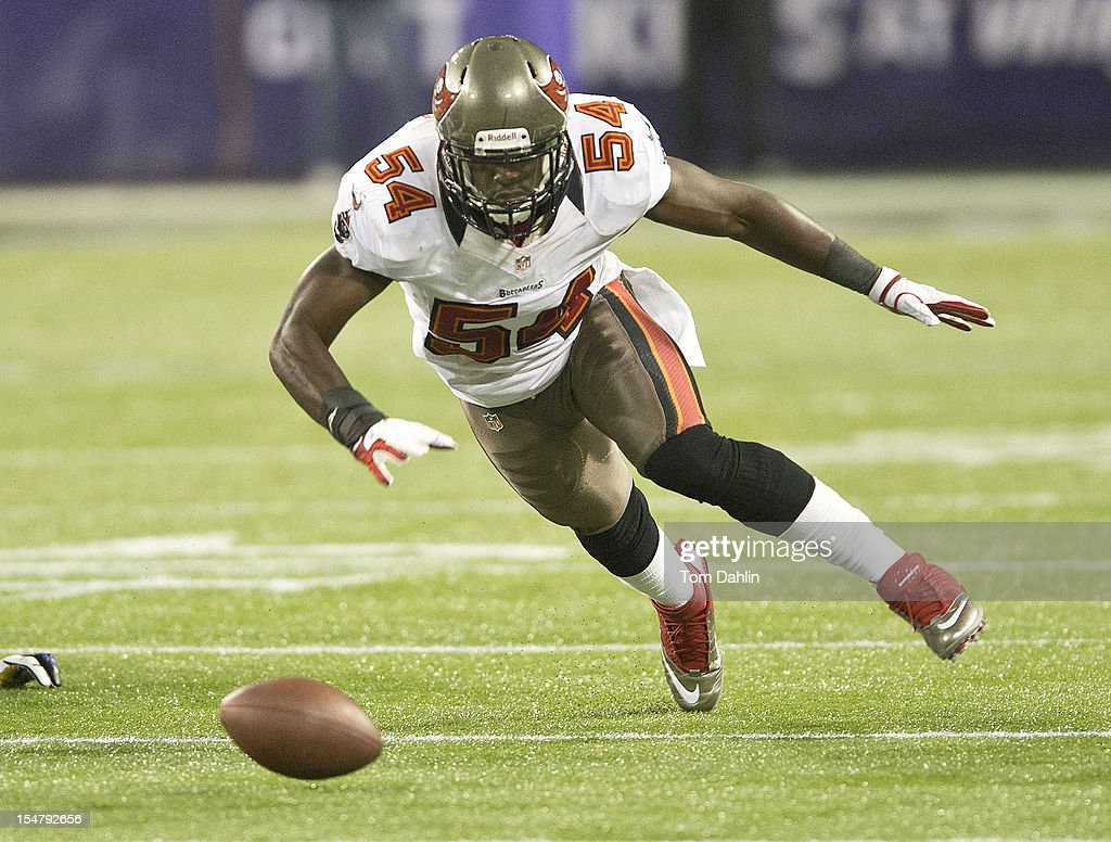 Lavonte David #54 of the Tampa Bay Buccaneers attempts to recover a fumble during an NFL game against the Minnesota Vikings at Mall of America Field at the Hubert H. Humphrey Metrodome on October 25, 2012 in Minneapolis, Minnesota.