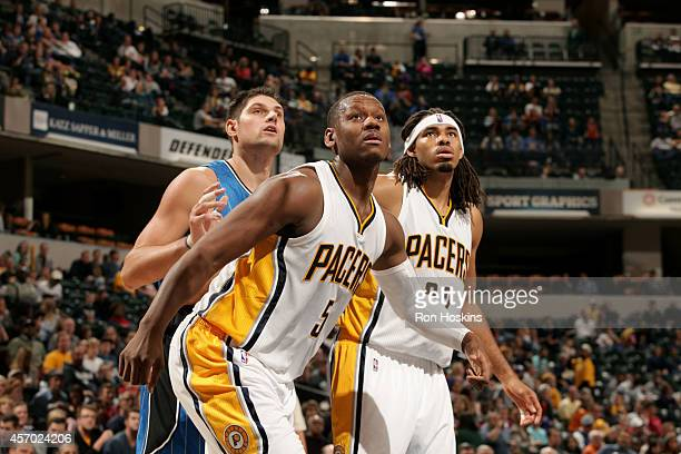 Lavoy Allen and Chris Copeland of the Indiana Pacers battle for position against Nikola Vucevic of the Orlando Magicat Bankers Life Fieldhouse on...