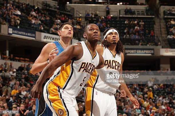 Lavoy Allen and Chris Copeland of the Indiana Pacers box out for a rebound during the game against the Orlando Magic at Bankers Life Fieldhouse on...