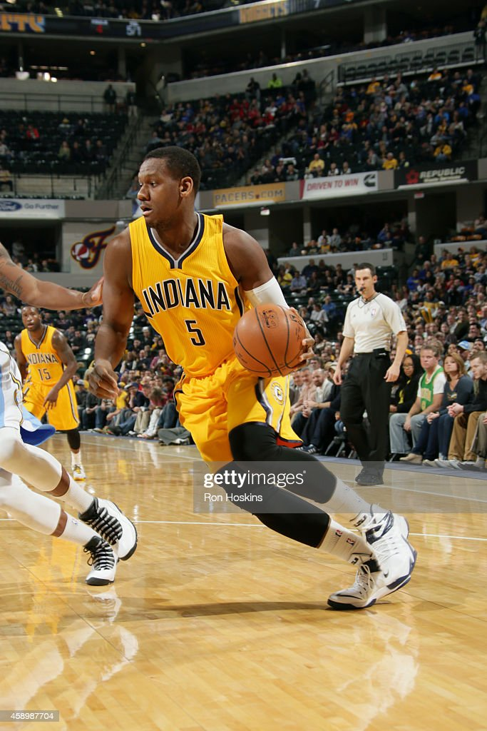 <a gi-track='captionPersonalityLinkClicked' href=/galleries/search?phrase=Lavoy+Allen&family=editorial&specificpeople=4628334 ng-click='$event.stopPropagation()'>Lavoy Allen</a> #5 of the Indiana Pacers drives against the Denver Nuggets on November 14, 2014 at Bankers Life Fieldhouse in Indianapolis, Indiana.