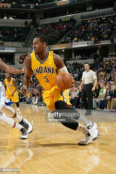 Lavoy Allen of the Indiana Pacers drives against the Denver Nuggets on November 14 2014 at Bankers Life Fieldhouse in Indianapolis Indiana NOTE TO...