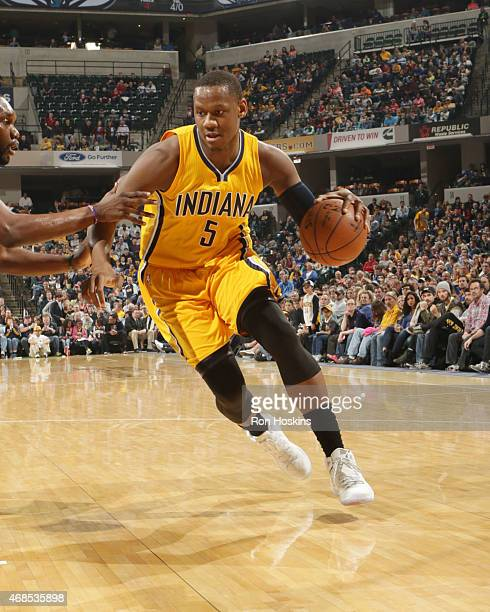 Lavoy Allen of the Indiana Pacers drives to the basket against the Charlotte Hornets during the game on April 3 2015 at Bankers Life Fieldhouse in...