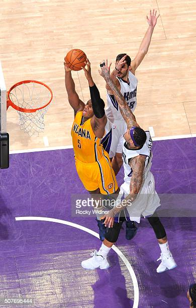 Lavoy Allen of the Indiana Pacers dunks against Willie CauleyStein of the Sacramento Kings on January 23 2016 at Sleep Train Arena in Sacramento...