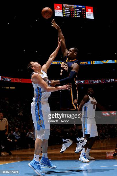 Lavoy Allen of the Indiana Pacers goes up for a shot against the Denver Nuggets on December 20 2014 at Pepsi Center in Denver Colorado NOTE TO USER...