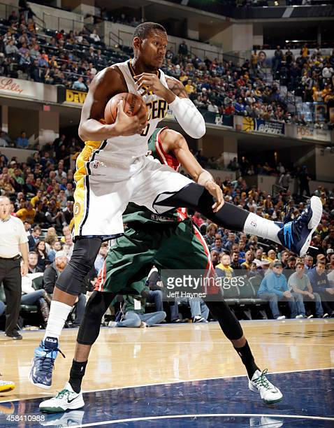 Lavoy Allen of the Indiana Pacers grabs a rebound against the Milwaukee Bucks at Bankers Life Fieldhouse on November 4 2014 in Indianapolis Indiana...