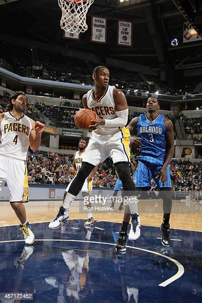 Lavoy Allen of the Indiana Pacers grabs a rebound during the game against the Orlando Magic at Bankers Life Fieldhouse on October 10 2014 in...