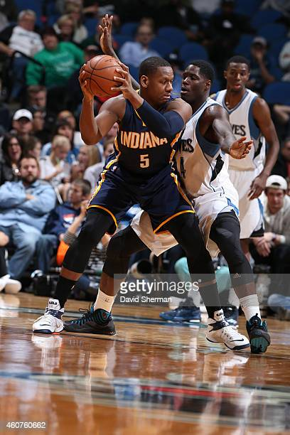 Lavoy Allen of the Indiana Pacers handles the ball against the Minnesota Timberwolves on December 21 2014 at Target Center in Minneapolis Minnesota...