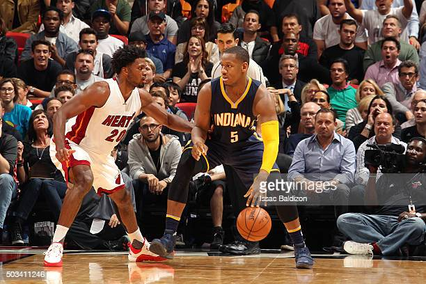 Lavoy Allen of the Indiana Pacers handles the ball during the game against the Miami Heat on January 4 2016 at AmericanAirlines Arena in Miami...