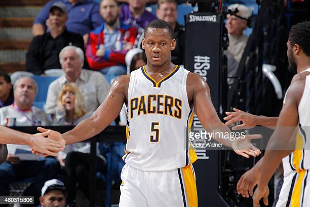 Lavoy Allen of the Indiana Pacers high fives teammates against the Sacramento Kings on December 5 2014 at Sleep Train Arena in Sacramento California...