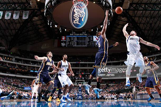 Lavoy Allen of the Indiana Pacers jumps against JJ Barea of the Dallas Mavericks for possession of the ball during the game on November 24 2014 at...