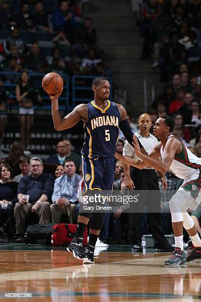 Lavoy Allen of the Indiana Pacers loks to pass against the Indiana Pacers on January 2 2015 at the BMO Harris Bradley Center in Milwaukee Wisconsin...