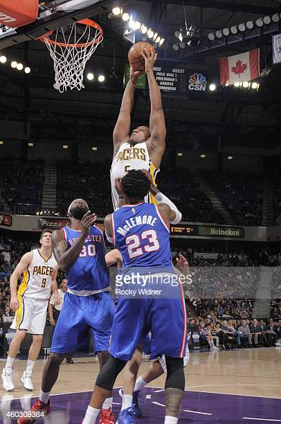 Lavoy Allen of the Indiana Pacers shoots against Reggie Evans and Ben McLemore of the Sacramento Kings on December 5 2014 at Sleep Train Arena in...