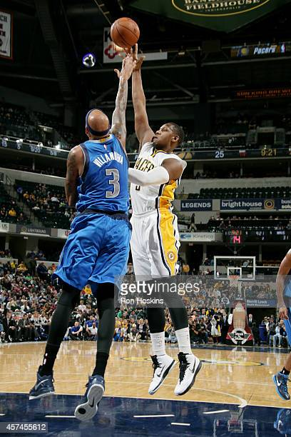 Lavoy Allen of the Indiana Pacers shoots against the Dallas Mavericks at Bankers Life Fieldhouse on October 18 2014 in Indianapolis Indiana NOTE TO...