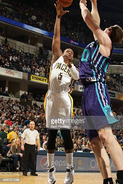 Lavoy Allen of the Indiana Pacers takes a shot against the Charlotte Hornets at Bankers Life Fieldhouse on November 19 2014 in Indianapolis Indiana...