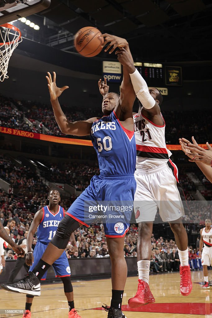 Lavoy Allen #50 of the Philadelphia 76ers battle for the ball control with J.J. Hickson #21 of the Portland Trail Blazers during the game between the Philadelphia 76ers and the Portland Trail Blazers on December 29, 2012 at the Rose Garden Arena in Portland, Oregon.