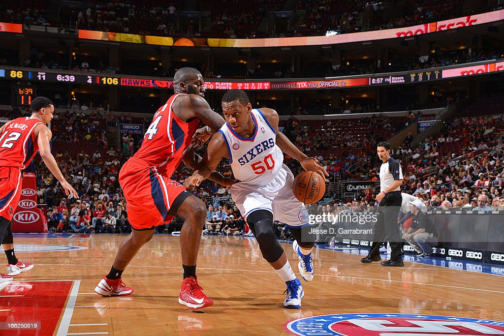 Lavoy Allen #50 of the Philadelphia 76ers drives against Ivan Johnson #44 of the Atlanta Hawks at the Wells Fargo Center on April 10, 2013 in Philadelphia, Pennsylvania.