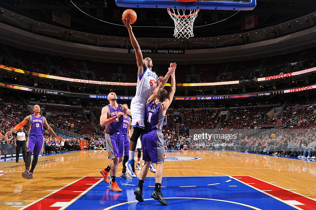 Lavoy Allen #50 of the Philadelphia 76ers drives to the basket against the Phoenix Suns at the Wells Fargo Center on November 25, 2012 in Philadelphia, Pennsylvania.