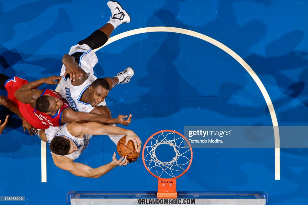 <a gi-track='captionPersonalityLinkClicked' href=/galleries/search?phrase=Lavoy+Allen&family=editorial&specificpeople=4628334 ng-click='$event.stopPropagation()'>Lavoy Allen</a> #50 of the Philadelphia 76ers goes for a rebound against <a gi-track='captionPersonalityLinkClicked' href=/galleries/search?phrase=Glen+Davis+-+Basketball+Player&family=editorial&specificpeople=709385 ng-click='$event.stopPropagation()'>Glen Davis</a> #11 and Nikola Vucevic #9 of the Orlando Magic during a pre-season game on October 11, 2012 at Amway Center in Orlando, Florida.